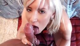 Beauty blonde is on her knees and she is blowing this tasty boner