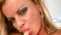 Slutty blonde with a tattoo is swallowing and blowing a huge hard dick